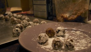 Rolling the balls in the confectioner's sugar
