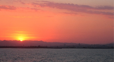 Sunset over barcelona, from the ferry